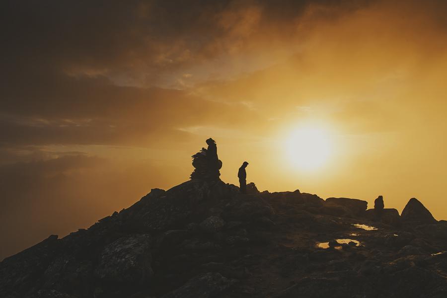 Boy walking while sunset