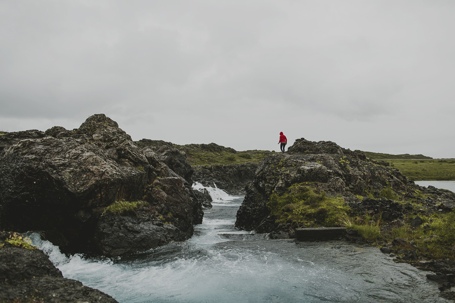 Girl hiking in Iceland wearing a red jacket