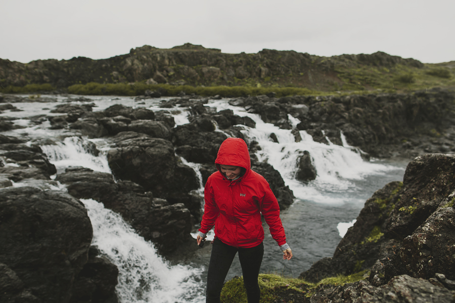 Girl wearing a red jacket in Iceland