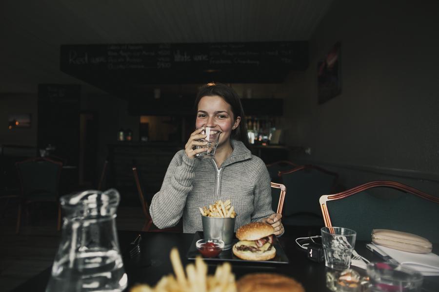 Girl eating hamburger and fries