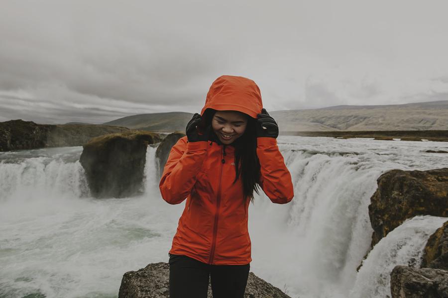 Girl in an orange jacket smiling