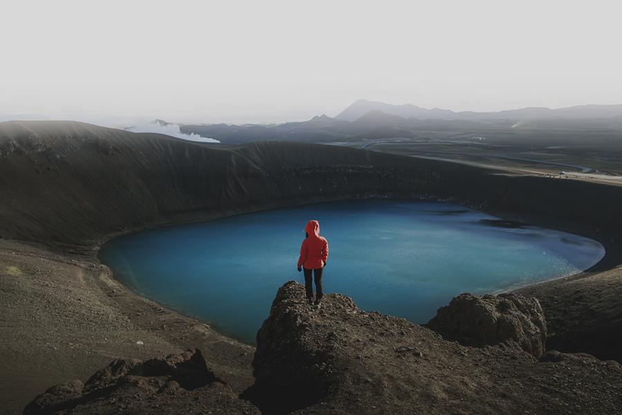 Girl looking standing in a vulcano