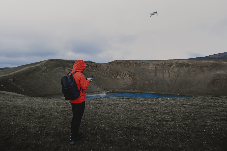 Girl flying a drone in Iceland