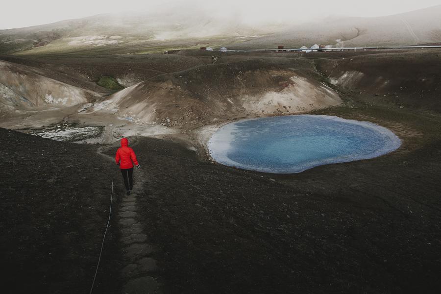 Girl walking down into a vulcano