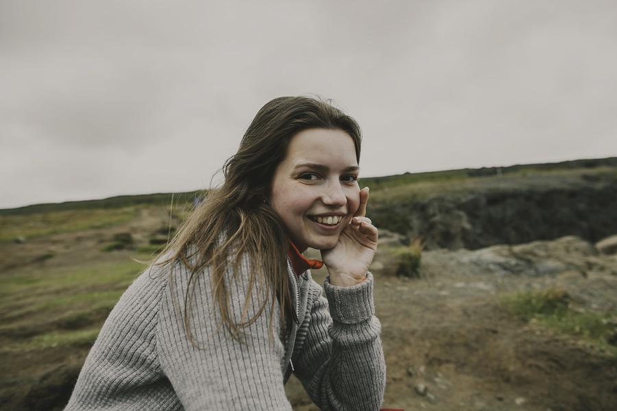 Girl smiling at Litlanesfoss