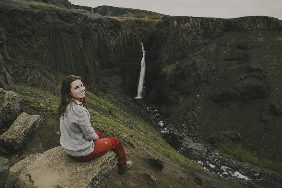 Girl looking at Litlanesfoss