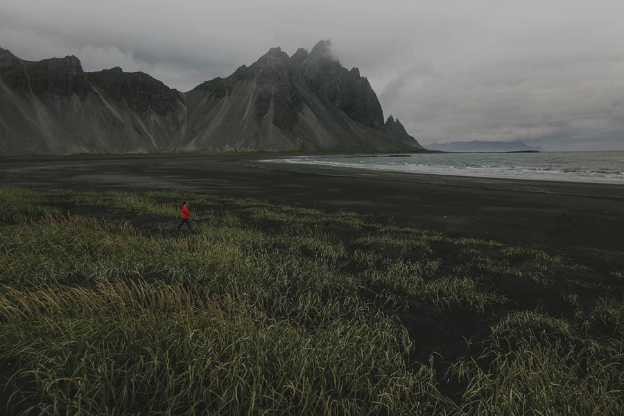 Girl walking on the beach Stokksnes