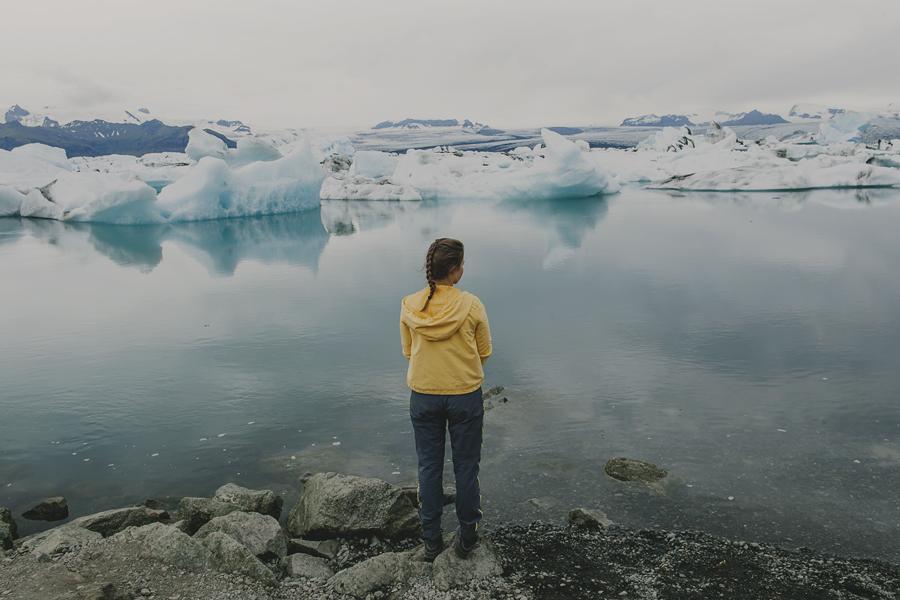 Girl wearing yellow at Jökulsárlón-Glacier lagoon