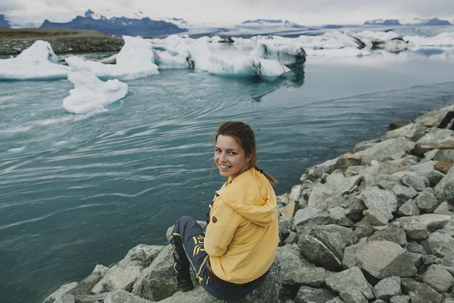 Girl in yellow at Jökulsárlón-Glacier lagoon