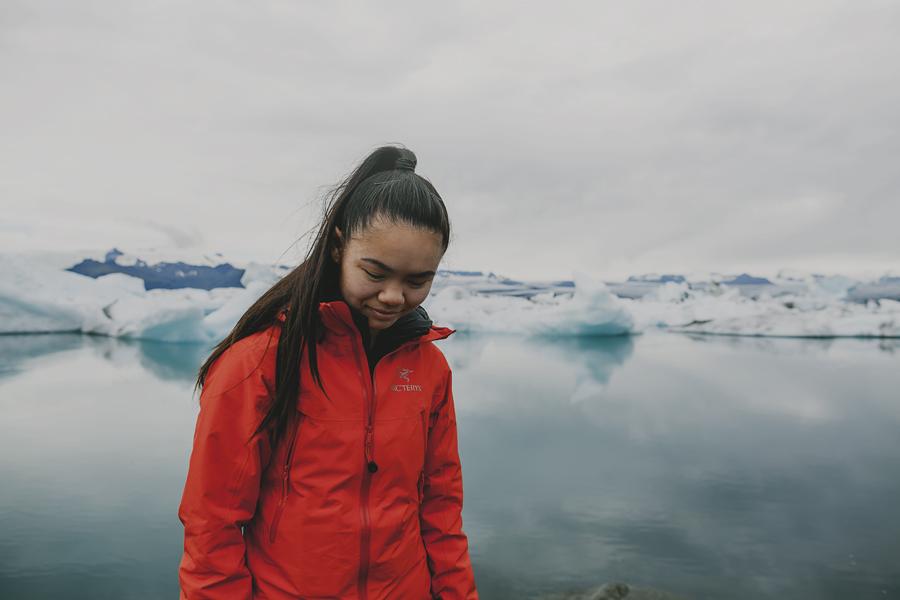 Girl wearing orange at Jökulsárlón-Glacier lagoon