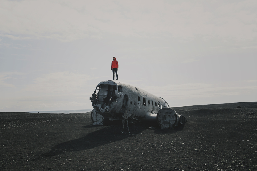 Girl standing on a plane wreck