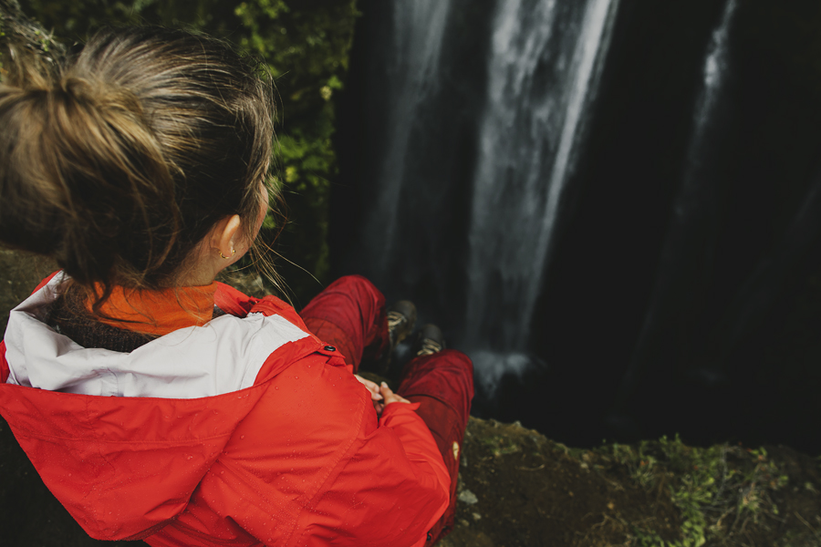 Girl looking down at a waterfall