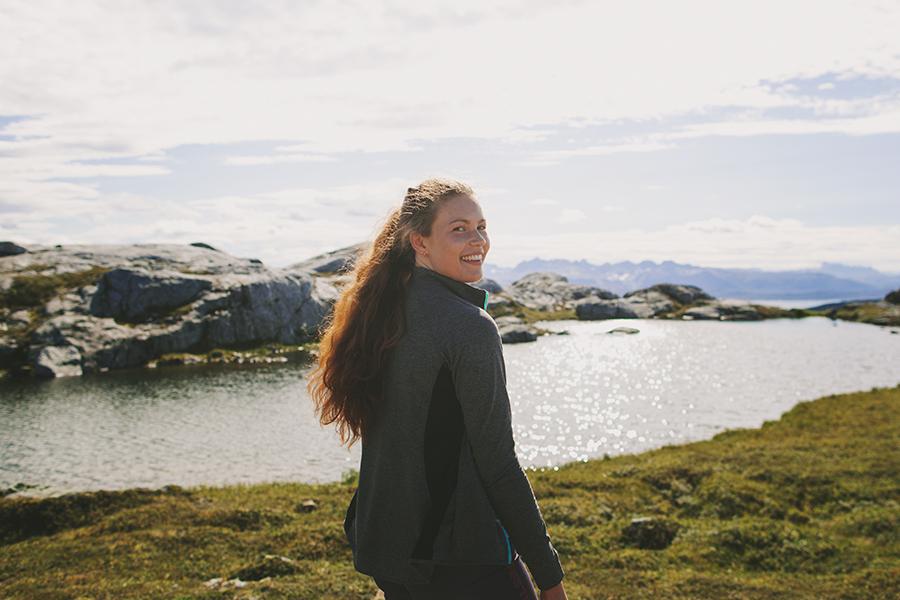 Smiling girl hiking to Steigtind
