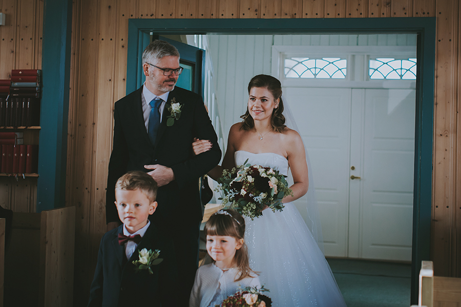 Proud dad walking his daughter down the aisle