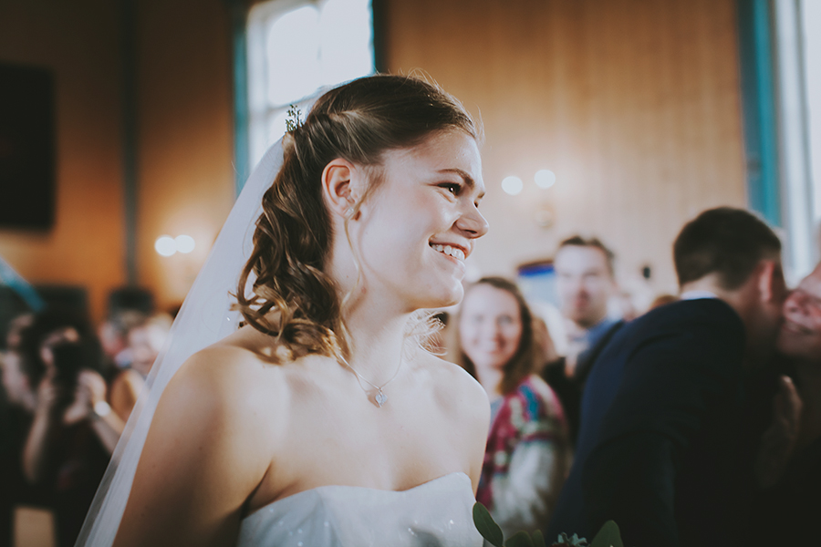 Bride smiling down the aisle