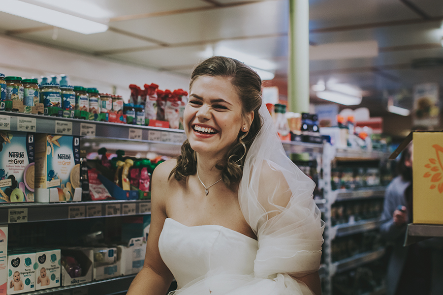 Bride smiling at a grocery store