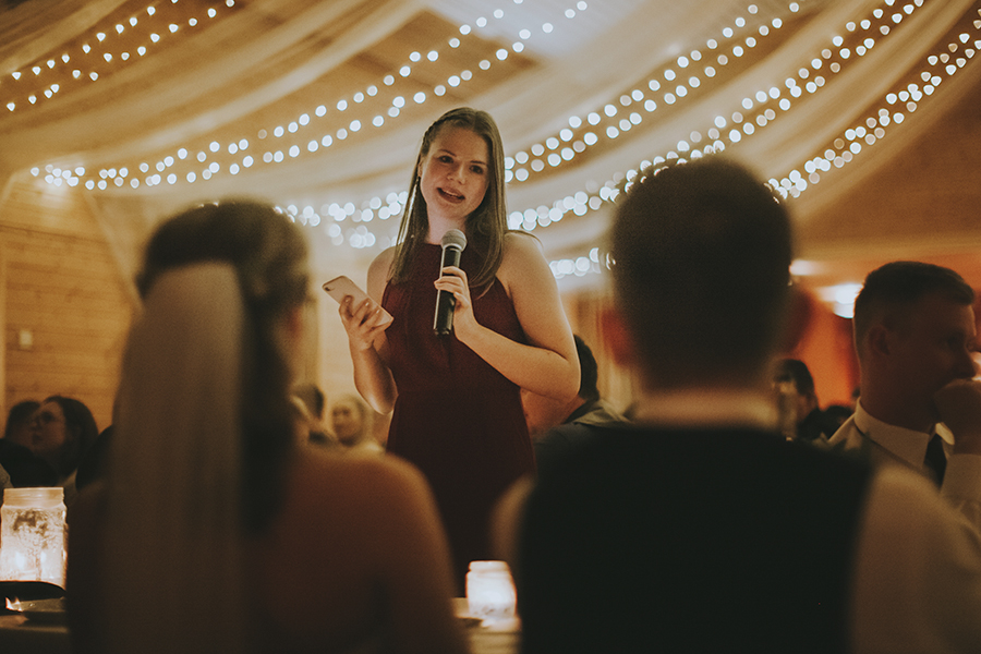 Maid of honor holding her speech