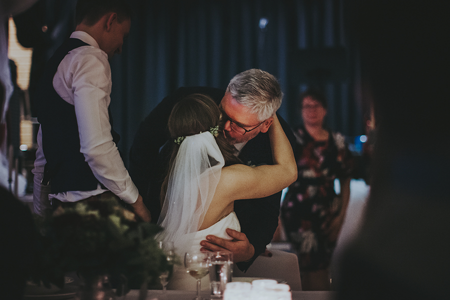 Dad kissing her daughter