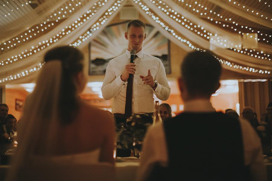 Best man holding his speech