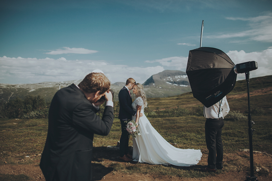 Photographer shooting pictures of a bridal couple