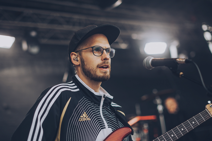 Man with glasses singing