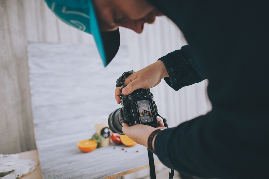 Photographer photographing fruit