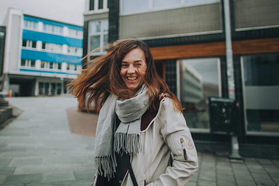 Girl with wind in her hair in Tromsø