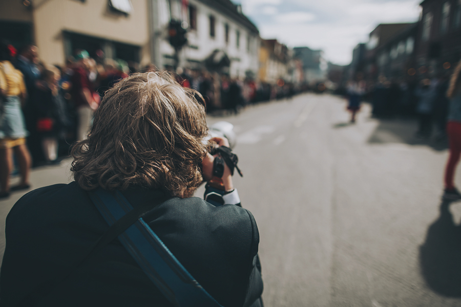 Man photographing the 17th of may parade