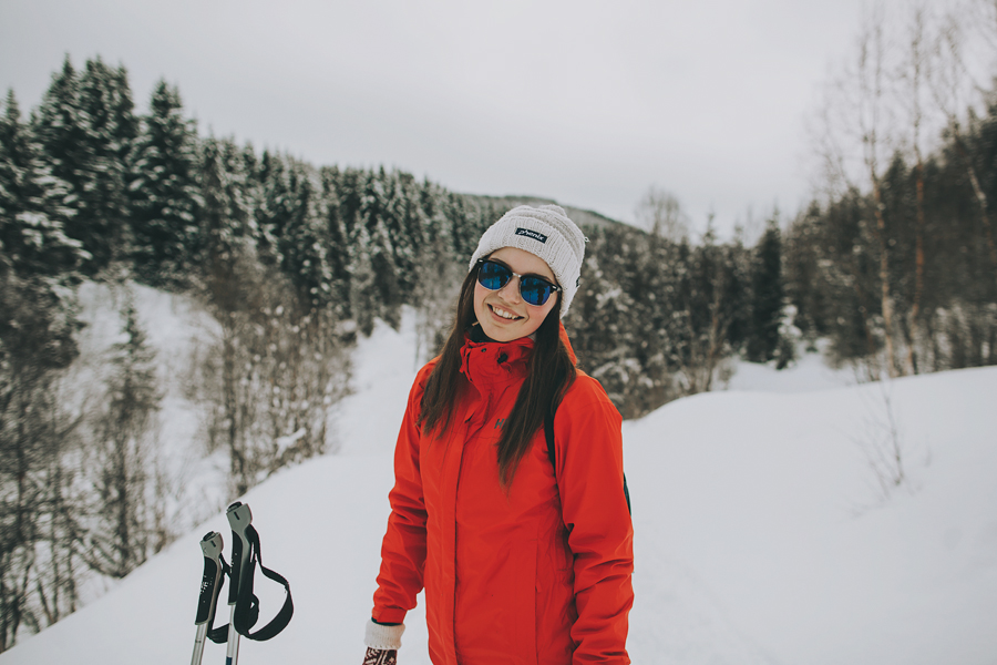 Girl in red jacket, sunglasses and a white cap