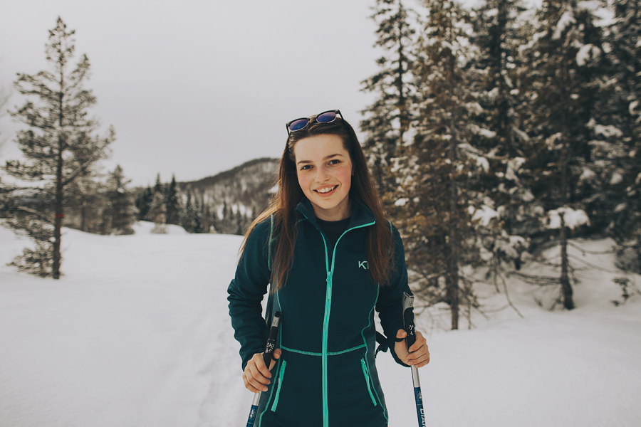 Girl smiling and skiing