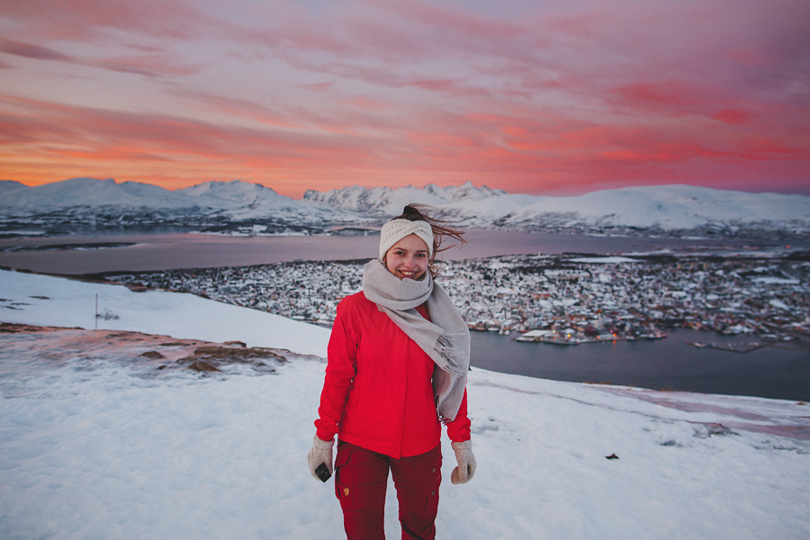 Girl in red with Tromsø as backdrop