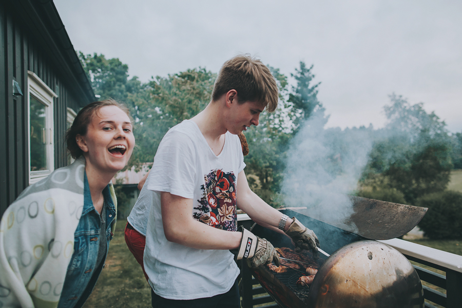 Girl and boy barbequing