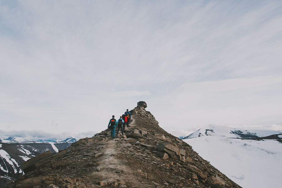 Four people hiking up to Trollsteinen
