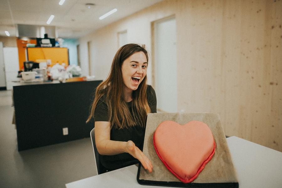 Girl holding a heart shaped cake