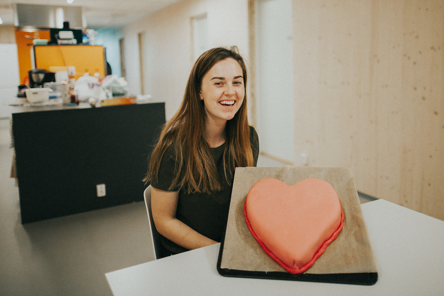 Girl smiling with a heart shaped cake