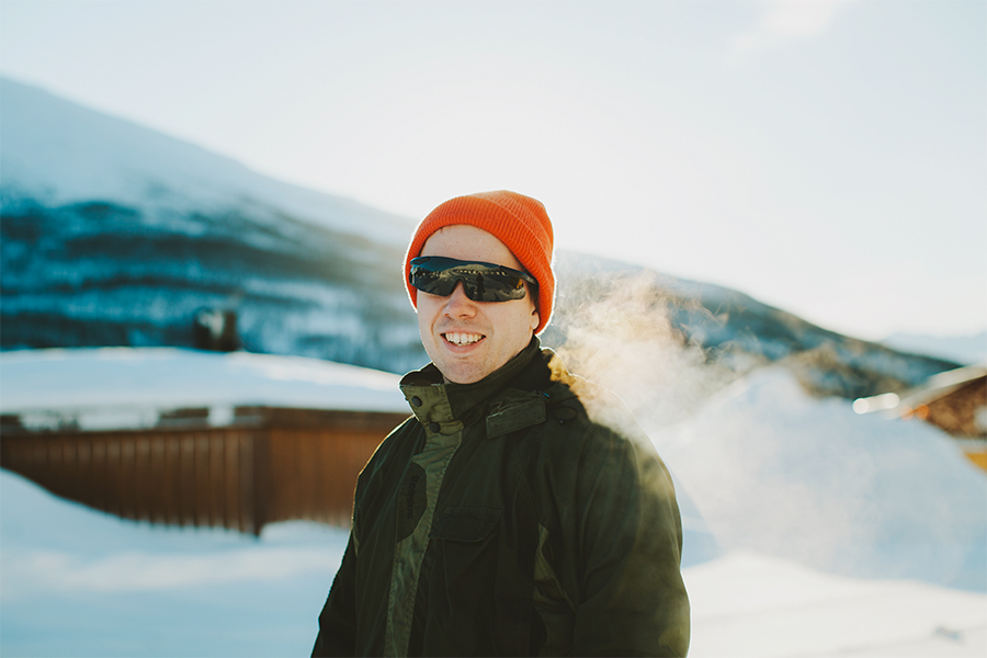 Guy with orange cap and sunglasses smiling