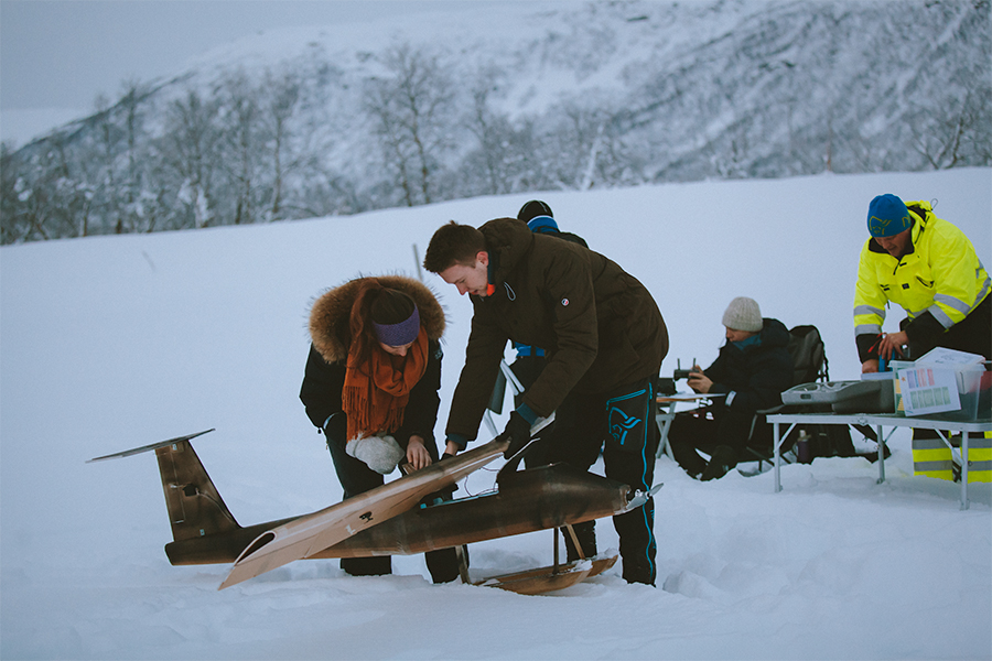 Girl, boy and a fixed-wing drone