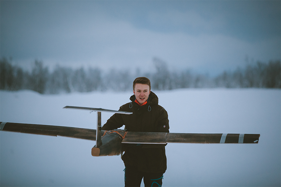 Boy and fixed-wing drone