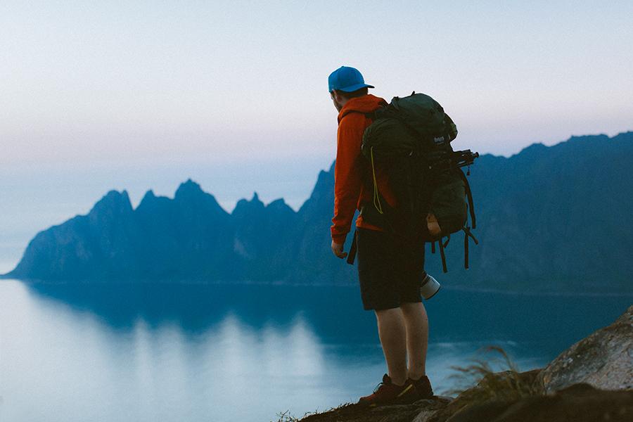 Hiker enjoying the view over Senja