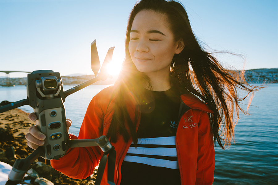 Girl holding a drone