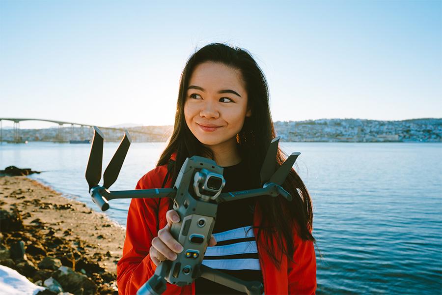 Girl holding a Mavic 2 Pro