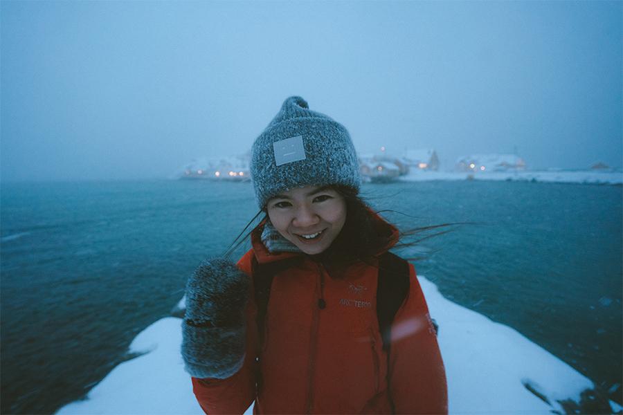 Girl in snow storm in Lofoten