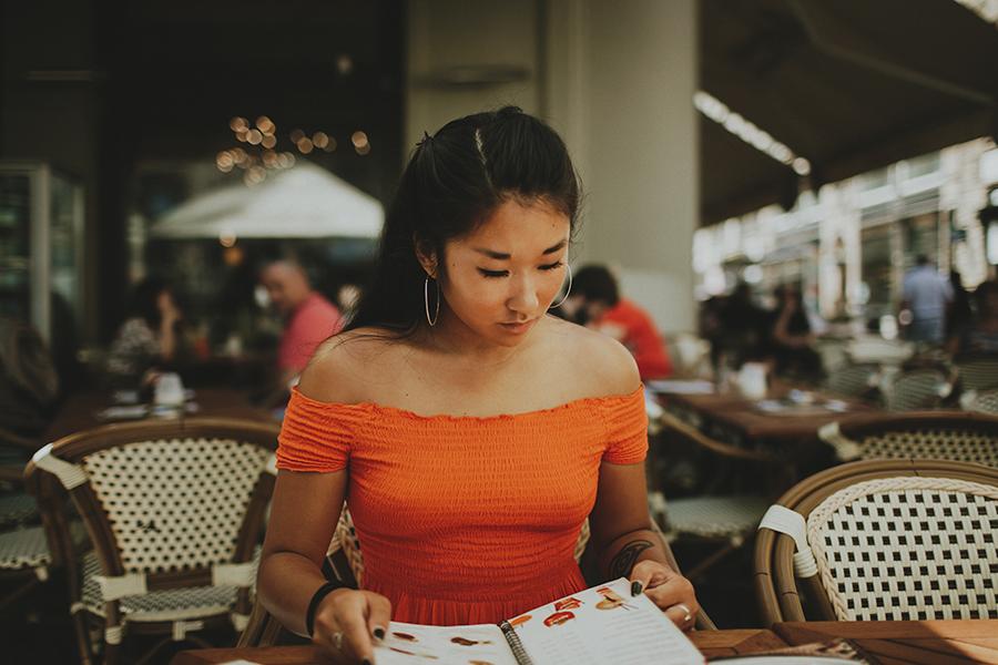 Girl lookin at the menu