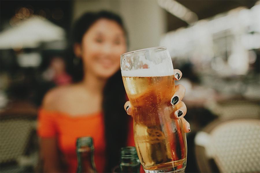 Girl holding a beer in Prague
