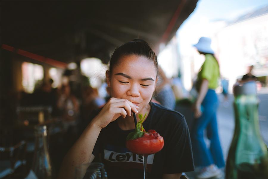 Girl drinking strawberry daiquiri
