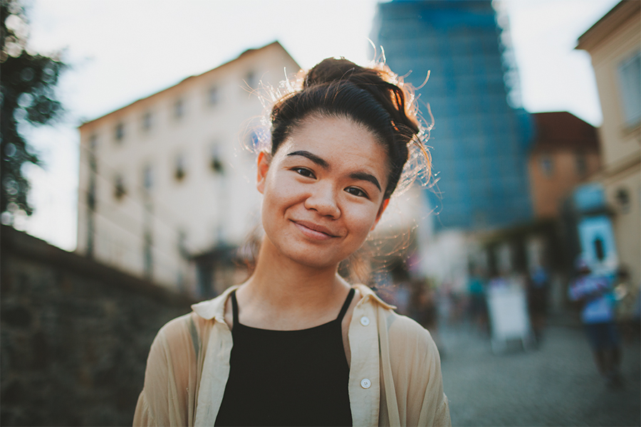 Girl with a big hair bun smiling