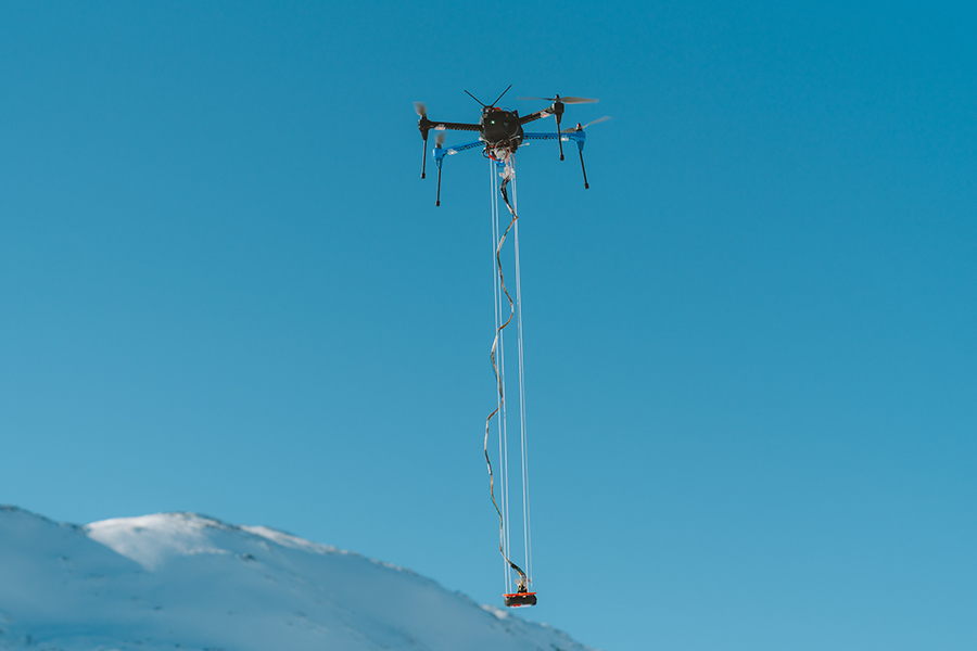 Drone with an avalanche beacon underneath