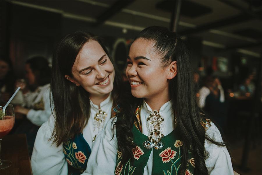 Two girls smiling and wearing Nordlandsbunad