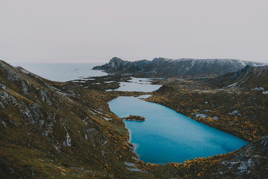 Blue lake and tall mountains in Andøya