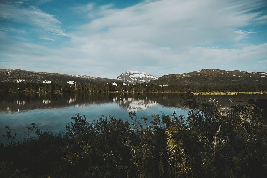 Mountain Tromsdalstiden reflected in Prestvannet in Tromsø